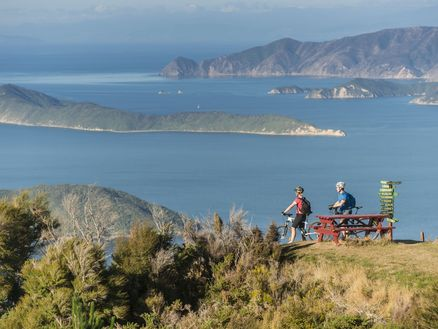Mountain bikers take in views of the Marlborough Sounds along the Queen Charlotte Track in New Zealand. Copyright Destination Marlborough