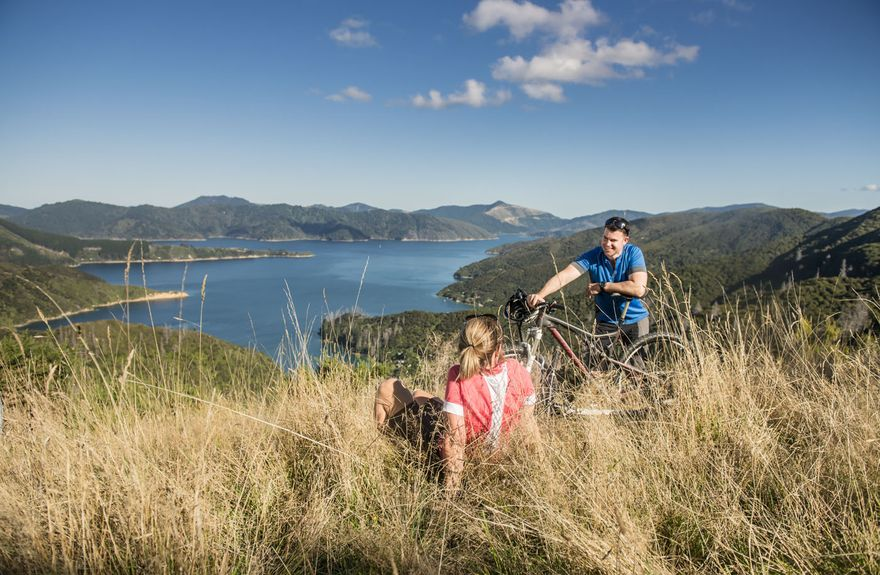 Mountain bikers rest overlooking Bay of Many