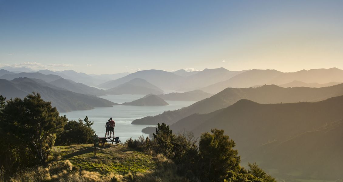 Taking a moment on New Zealand's Queen Charlotte Track in the Marlborough Sounds. Copyright Destination Marlborough